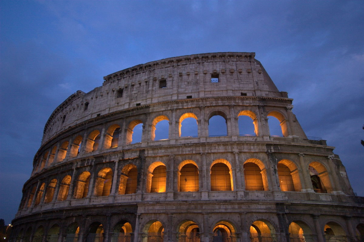 "A picture of the Colosseum in Rome from the outside. In this case, the picture is symbolic of committing to something 100%: of being the ""man in the arena."""