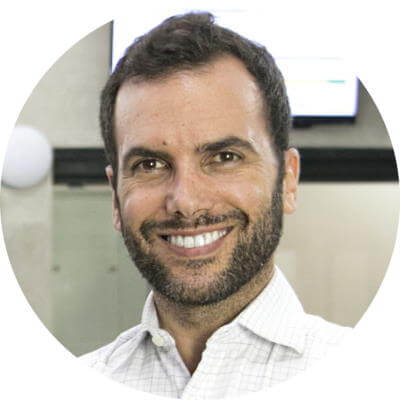 A headshot of Itamar Gero, founder of SEO Reseller. He has short, dark hair, a close-cropped beard, and is wearing a white, button-down shirt with the top button open at the neck. He wrote the article on digital marketing campaigns and his headshot and author bio appear at the bottom.