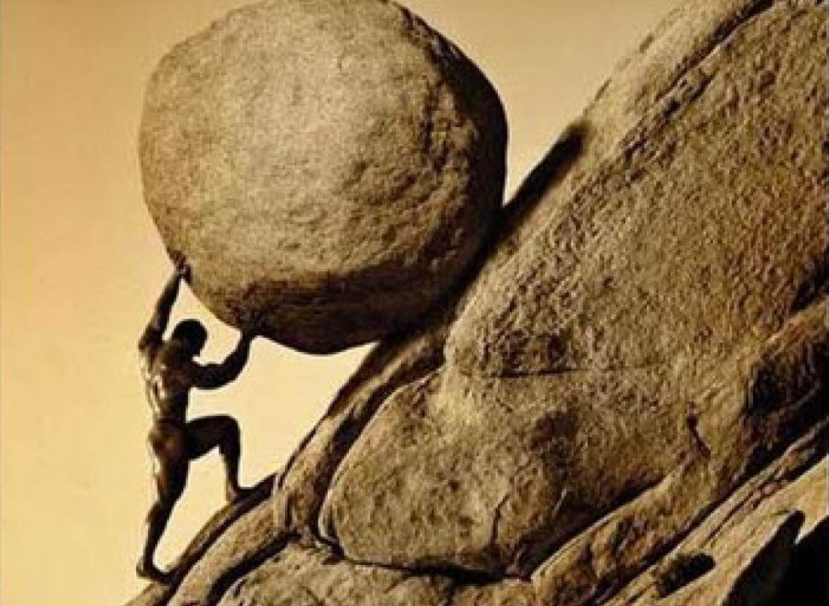 A picture of Sisyphus toiling away, pushing his boulder up the hill.