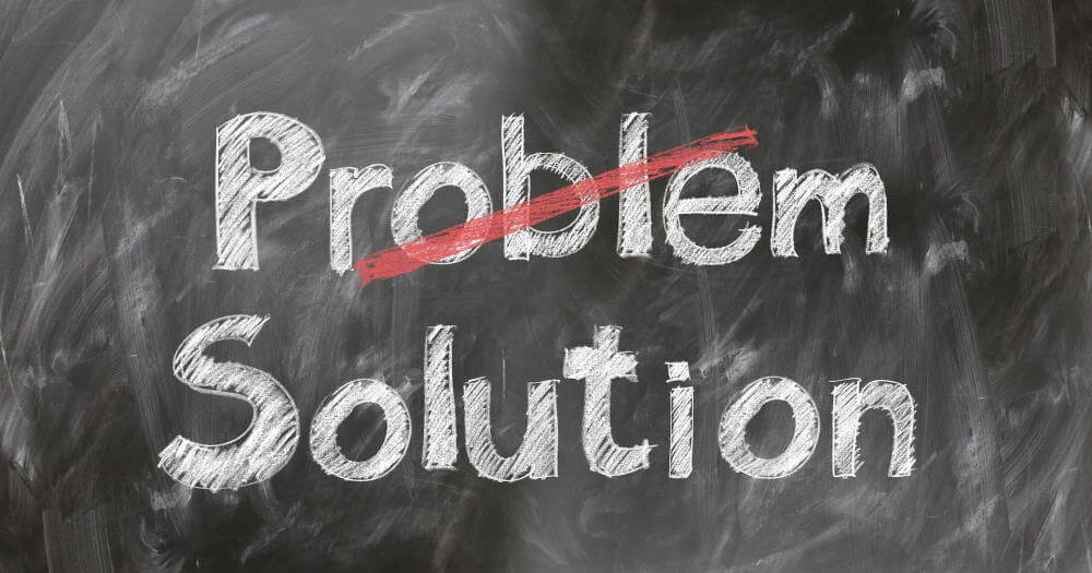 "If you want to talk to your boss about a problem, it's best to be solution-focused. This image is a chalkboard with two words written on it in white chalk: ""Problem"" and ""Solution"". The word ""Problem"" is crossed out in red chalk."